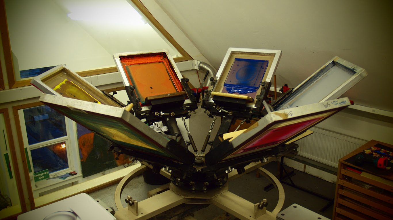 screen printing screens on a Carousel set up ready for printing